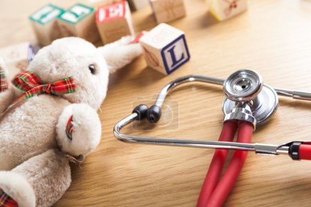 Stethoscope with toys on  table
