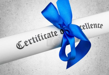 Diploma tied with blue ribbon
