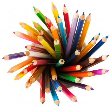 colour pencils in ceramic cup
