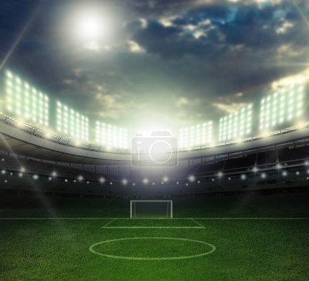stadium in night illuminated spotlights