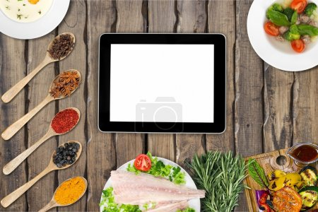 Photo for Preparation table in kitchen for cooking with tablet - Royalty Free Image