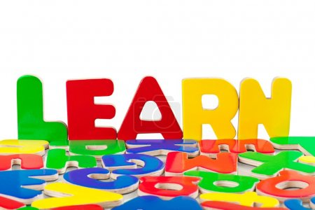 The word learn with plastic letters
