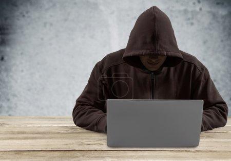 Cyber hacker using laptop