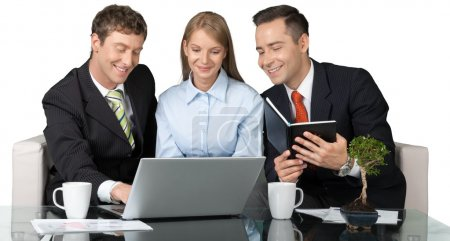 Happy business team  with laptop