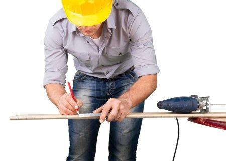 Male worker in yellow helmet