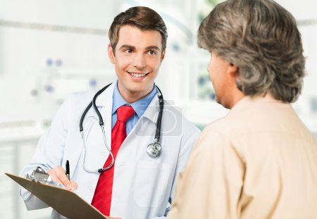 Smiling male patient with doctor