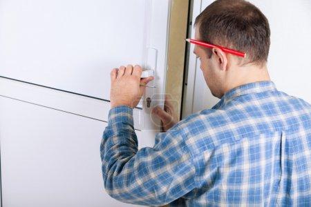 locksmith installing a door lock