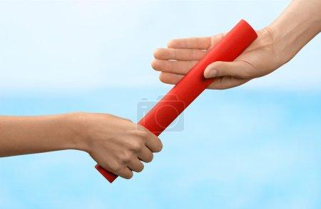 relay baton being passed