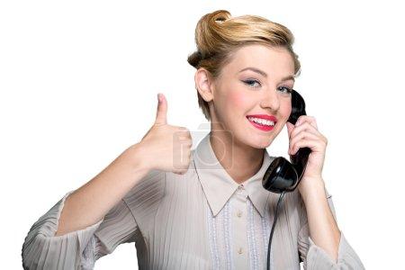 woman speaking on  vintage phone