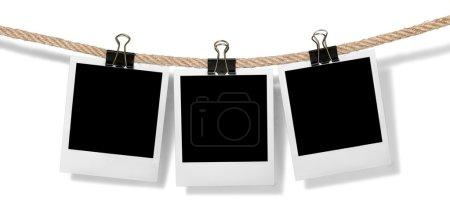 Photo pour Cadres photo instantanés suspendus isolés sur blanc - image libre de droit
