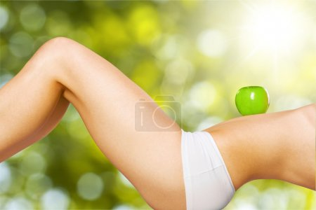 female body  with green appple