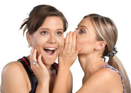Photo pour Femme révélant un secret à son ami - image libre de droit