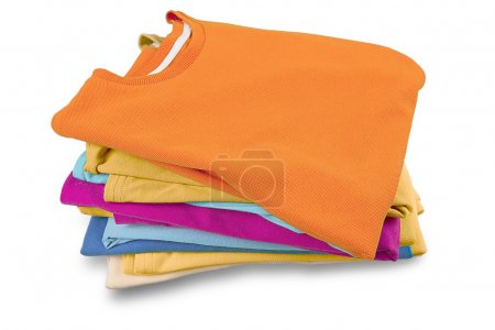 Photo for Stack of folded garments. Closeup over white background. - Royalty Free Image