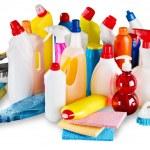 Plastic bottles, cleaning sponges on white backgro...