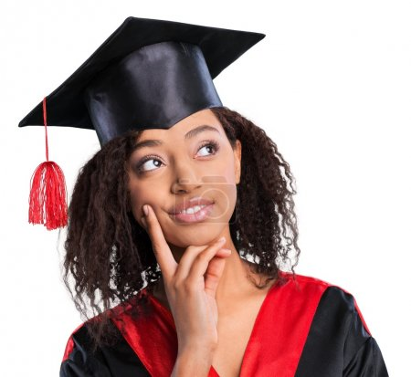 Photo for Young Afro American female student dressed in black graduation gown - Royalty Free Image