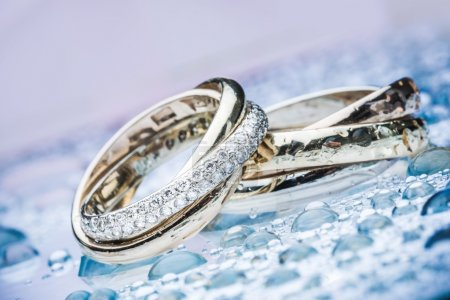 Engagement rings on background