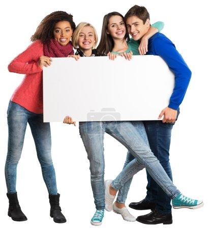 teens holding blank banner