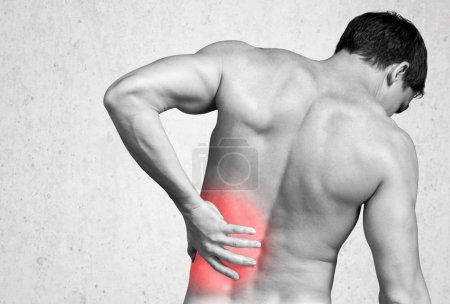 Photo for Strong man with back pain, back view - Royalty Free Image