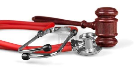 gavel and stethoscope  on background