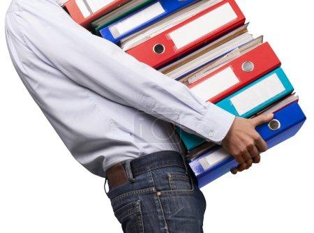 office worker holding binders