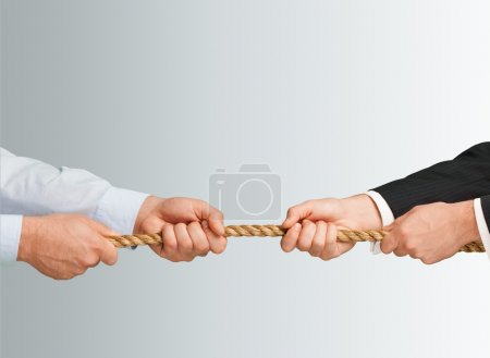 businessman pulling a rope in opposite directions