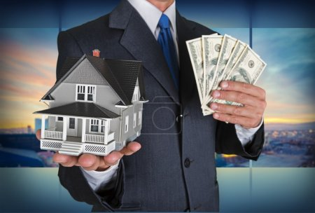 businessman with  house and US dollars