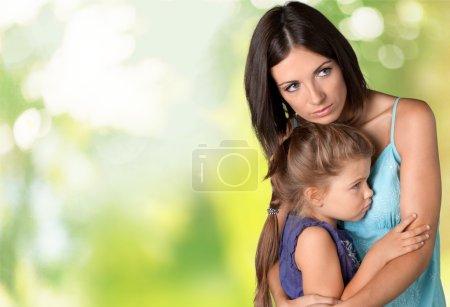 Mother hugging her little daughter