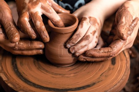 hands of potter doing  clay pot