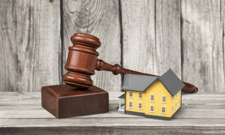 Wooden judge gavel and toy  house