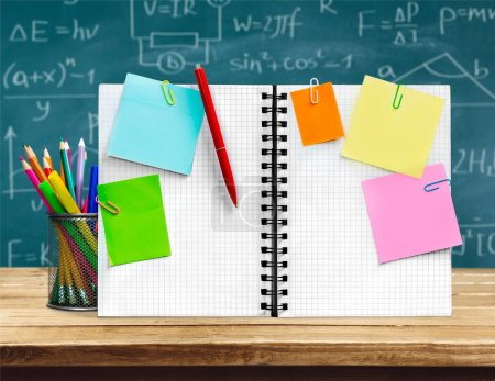 Open blank notepad and school stationery