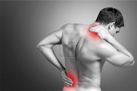 Photo for Strong man with neck pain, back view - Royalty Free Image