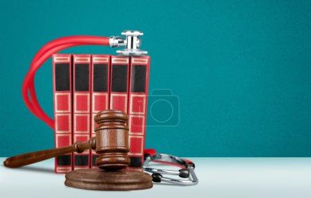 Gavel and stethoscope  on background, symbol photo...