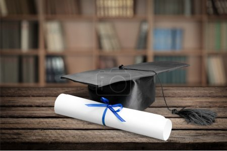Photo for Graduation mortarboard and diploma on  background - Royalty Free Image