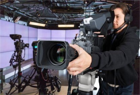 Cameraman working with camera