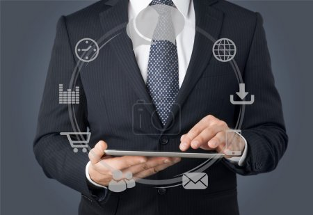 businessman and tablet pc  with  sketches