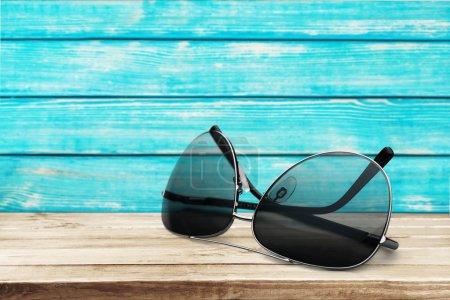 Sunglasses on beach  background