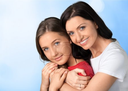 Photo for Beautiful Mother and Teenager Daughter Hugging - Royalty Free Image