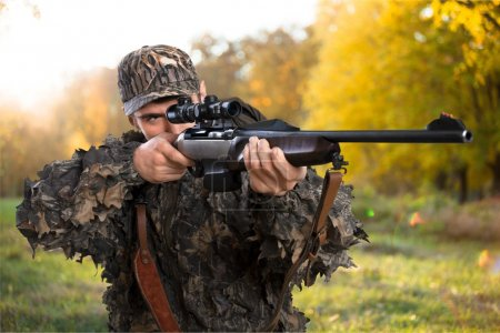 Male Hunter with Rifle