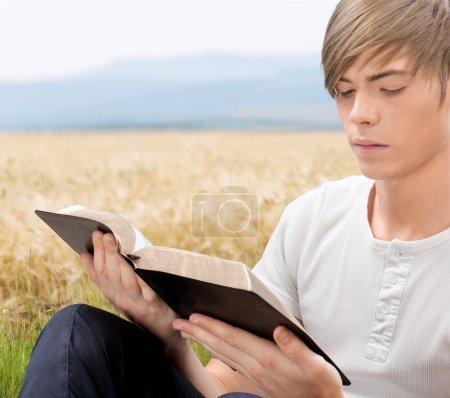 Man holding  bible book