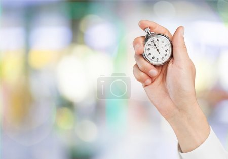 Stopwatch in Human Hand