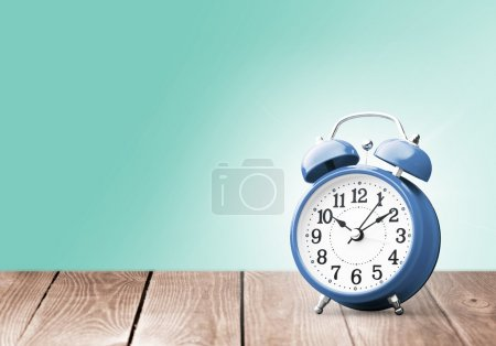 Photo for Retro alarm clock on table  background - Royalty Free Image