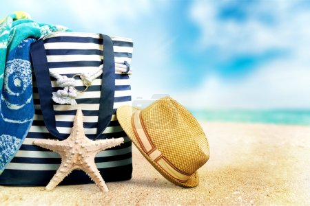 Straw hat and bag  on  beach
