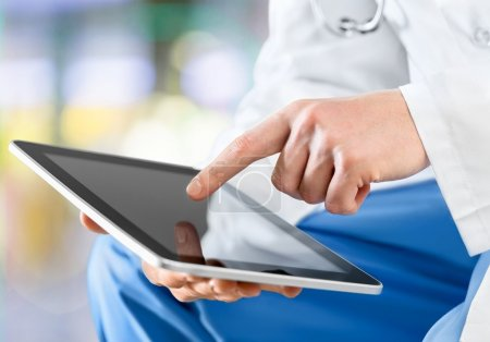 Doctor working with tablet pc