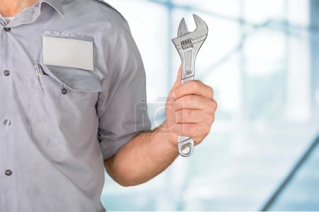 engineer holding open end wrench