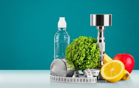 Photo for Dumbbell with bottled water , measuring tape and fruits isolated - Royalty Free Image