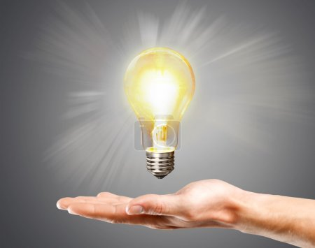 LED bulb with lighting in hand