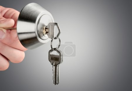 hand with house key and lock