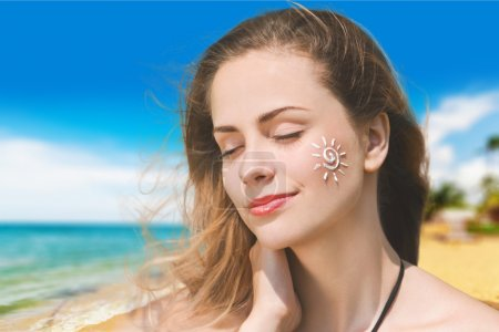 Woman with Sunscreen Solar Cream