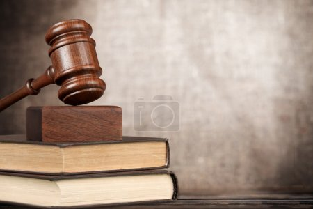books and wooden gavel on table