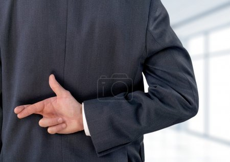 Businessman with his fingers crossed